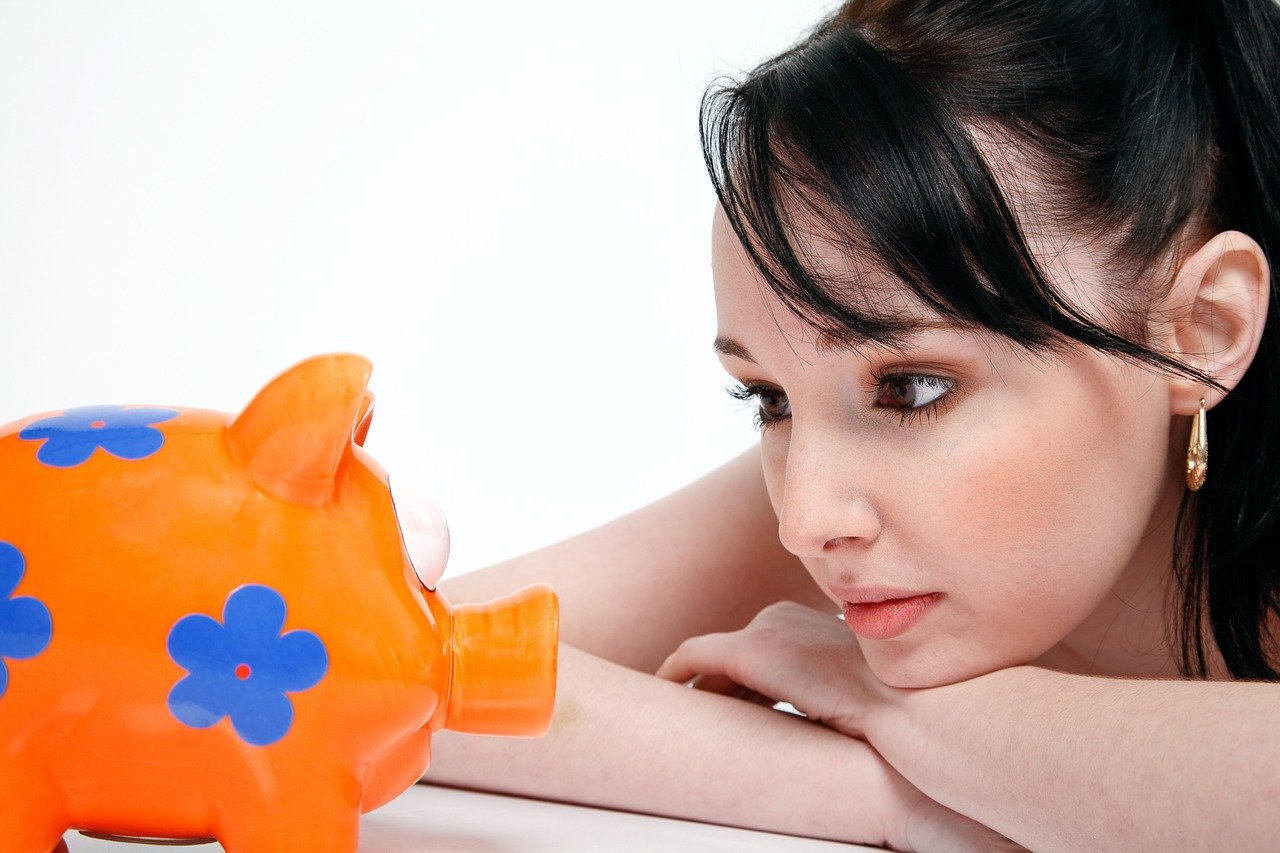 piggy-bank-saving-money-young-woman-850607